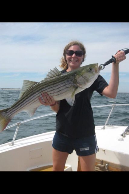Our First Mate Christine shows off her large striper caught on the Merrimack RIver, MA